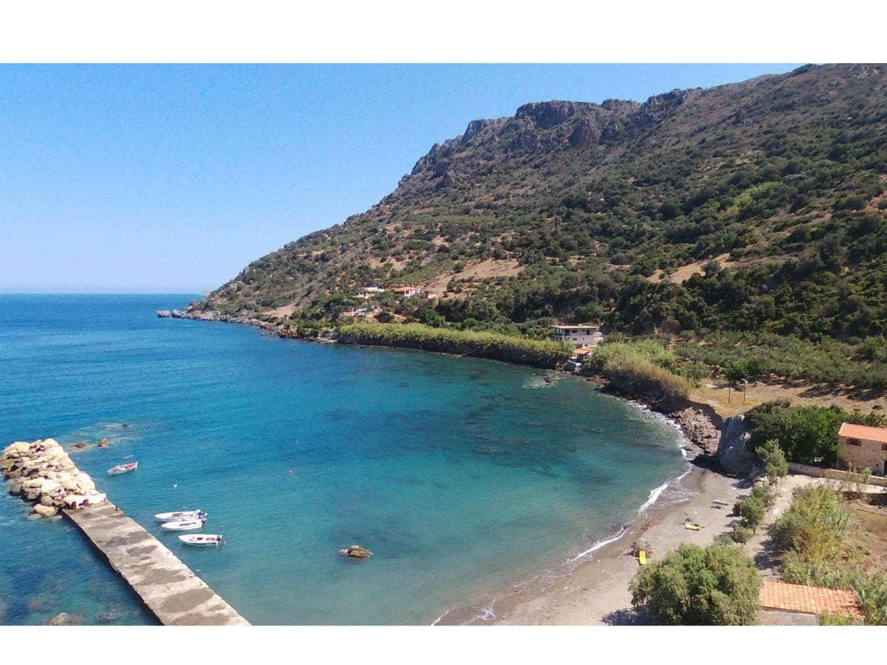 The small port of Ravdoucha and Neratzia Beach